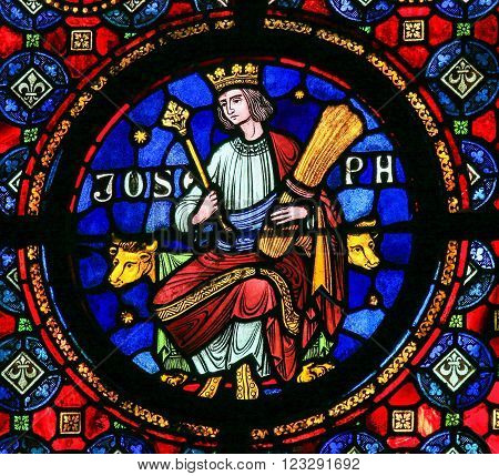 DINANT, BELGIUM - OCTOBER 16, 2011: Joseph (son of Jacob), son of Jacob in the Hebrew Bible book of Genesis, depicted on a stained glass window in Dinant, Belgium.