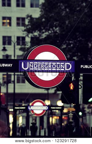 LONDON, UK - SEP 27: Undergroud sign in London Street on September 27, 2013 in London, UK. London is the world's most visited city and the capital of UK.