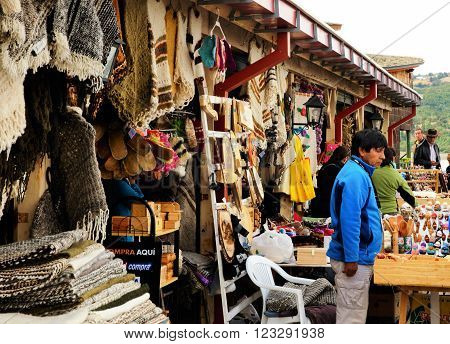 DALCAHUE, CHILE - MARCH 13, 2016: Man is selling his products on a craft fair on March, 13, 2016 in Dalcahue, Chile.