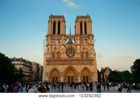 PARIS, FRANCE - MAY 13: Notre Dame de Paris cathedral with tourists at sunset on May 13, 2015 in Paris. With the population of 2M, Paris is the capital and most-populous city of France