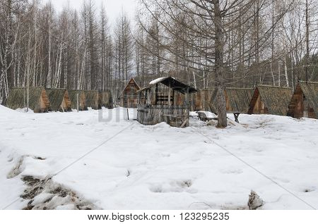 Irkutsk Region, Russia -March,20 2016: Former tourist camp in countryside with a wooden dwelling. kochergat village Irkutsk Region Russia