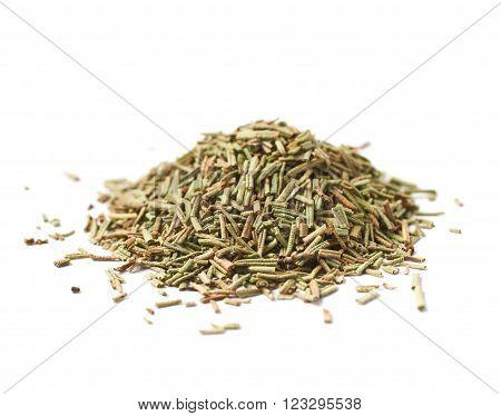 Pile of dried rosmarinus seasoning isolated over the white background