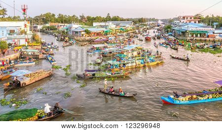 Soc Trang, Vietnam - February 3rd, 2016: Landscape morning floating market wetland busiest night with boats transporting agricultural products to trade in this sunny morning preparing for the Lunar New Year in wetland Soc Trang, Vietnam