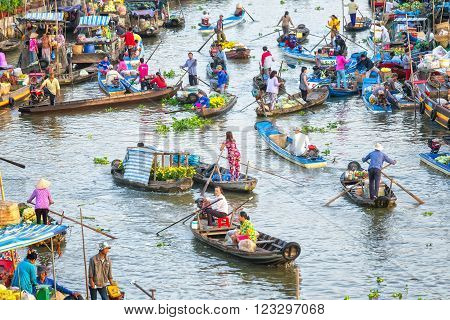 Soc Trang, Vietnam - February 3rd, 2016: Landscape bustling morning crowded living on floating market with dozens of boats transporting flowers, agricultural products, vegetables river lively trade in Soc Trang, Vietnam