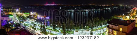 Can Tho, Vietnam - February 3rd, 2016: Panorama of the night city Can Tho Ninh Kieu wharf river with many sparkling lights, so far as the Can Tho Bridge shines at night makes more lively night scene in Can Tho, Vietnam