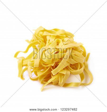 Pile of fresh raw fettuccine ribbon pasta isolated over the white background ** Note: Soft Focus at 100%, best at smaller sizes