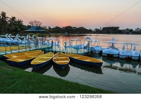Yellow rowboats anchored at harbor in evening