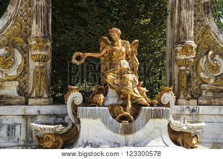 golden fountains in segovia palace in Spain. bronze figures of mythological gods and classic
