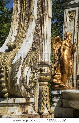park, golden fountains in segovia palace in Spain. bronze figures of mythological gods and classic