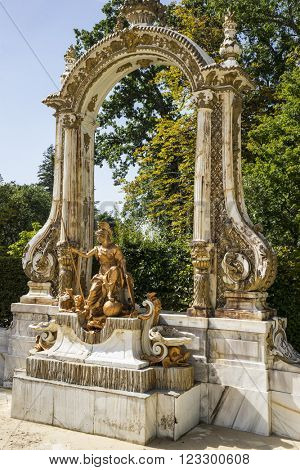heritage golden fountains in segovia palace in Spain. bronze figures of mythological gods and classic