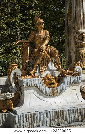 sculpture, golden fountains in segovia palace in Spain. bronze figures of mythological gods and classic