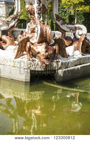 dragon, golden fountains in segovia palace in Spain. bronze figures of mythological gods and classic