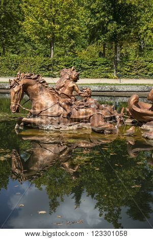 horses, golden fountains in segovia palace in Spain. bronze figures of mythological gods and classic