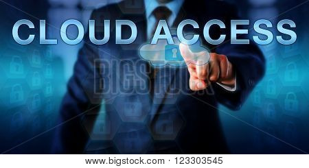 Corporate manager is pushing CLOUD ACCESS on a touch screen interface. Information technology metaphor and network security concept for authorization mechanisms controlling cloud resource usage.