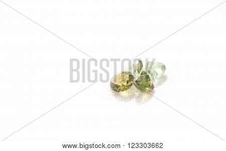 tourmaline cut gemstone crystals on a white background