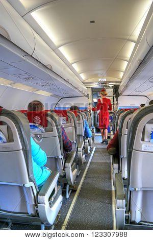ELLINAIR GREECE - March 18.2016: Stewardess checks up an order in a salon aboard the airplane prepared to flight
