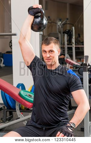 Athlete With Heavy Weights Above His Head At Arm's Length
