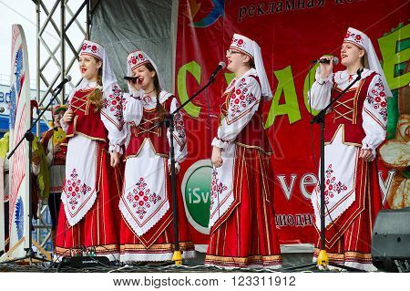 GOMEL BELARUS - MARCH 12 2016: Performance of creative choral collective. The concert was conducted in the open air with open free access for all comers during mass Shrovetide celebrations