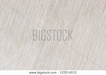 The beige texture cloth. The ribbed canvas. The backgroung.