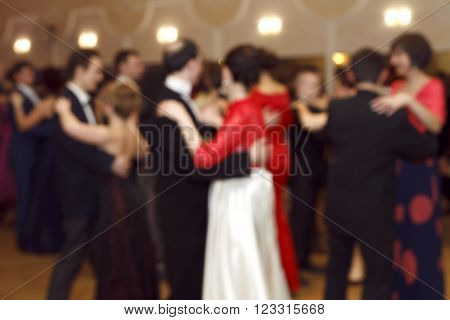Ball , waltz   dance , ancient traditions  , blurred figures of dancing couples