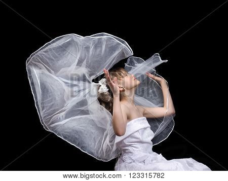 Girl teenager in a wedding dress and a flowing veil. The concept of early marriage, dreams of a wedding. The child is underage. The marriage of children