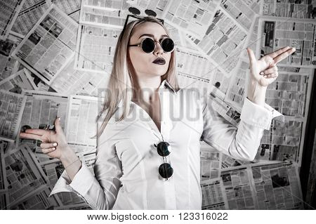 Blonde Surrounded With Newspapers