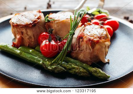 Meaty holiday dinner on a wooden table. Tasty holiday meat with fresh vegetables. Dinner in restaurant of mediterranean cuisine