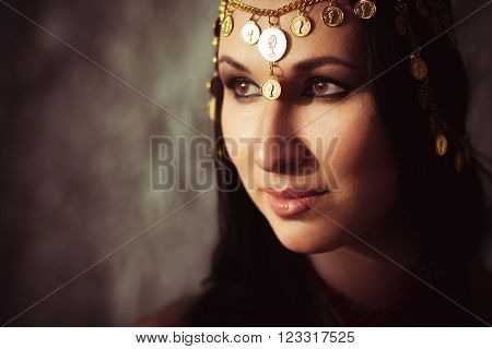 Attractive woman with indian indian tikka. Traditional indian jewellery on indian woman head. Portrait of indian girl with traditional indian accessories