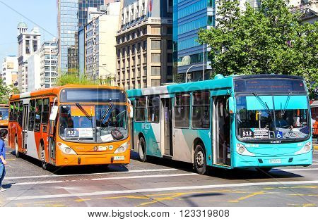 SANTIAGO, CHILE - NOVEMBER 13, 2015: City buses Marcopolo Gran Viale and Caio in the city street.