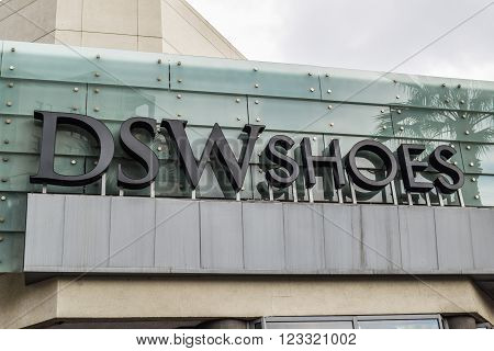 Los Angeles, CA, USA . January 16, 2016: DSW Shoes logo sign exterior in Los Angeles Hollywood boulevard . DSW Inc. is a speciality branded footwear retailer.