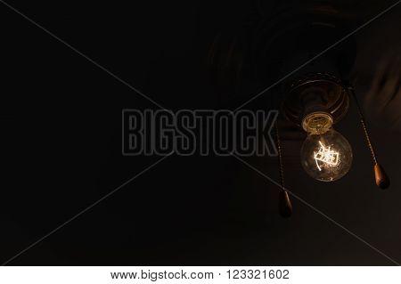Retro vintage fan with Edison's lamp. Movement.