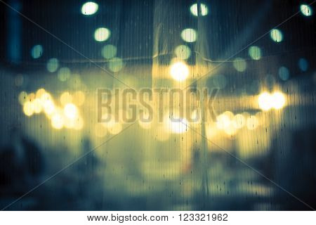 Dark and vintage abstract background of night bokeh through light curtain