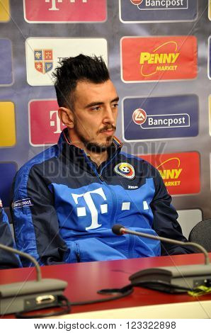 The Coach And Players Of Romania's National Football Team During A Press Conference