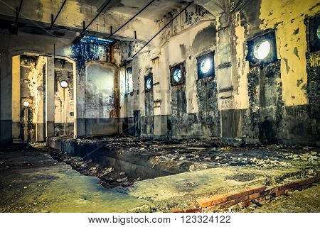 Abandoned building with light shining through round windows