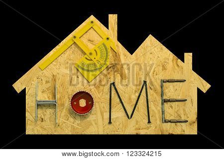 Home repair concept. Fixing materials and tools on a sheet of OSB in the form of home. Isolated objects on a black background.