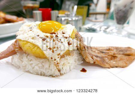 Pork, Egg, Pineapple Rice On White Dish