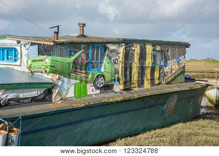 Shoreham-on-Sea ,UK - February 6 2016: Old barge converted into a house boat with part of a car built into the design