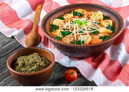 tortellini soup with italian sausages spinach tomato parmesan cheese