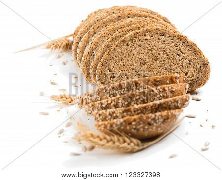 Wholegrain bread with seeds isolated on a white background.