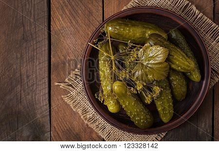 Pickled Cucumbers On A Dark Wooden Background. Top View