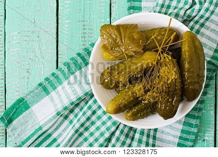 Pickled Cucumbers On A Light Wooden Background. Top View