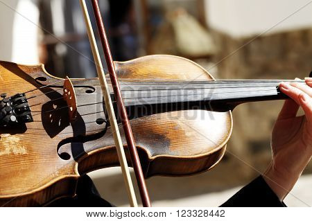violinist playing the instrument, close-up, background music