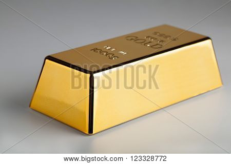 closeup of gold bullion on a light background