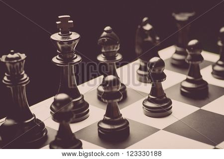 Close-up image of a chess board with chess pieces.