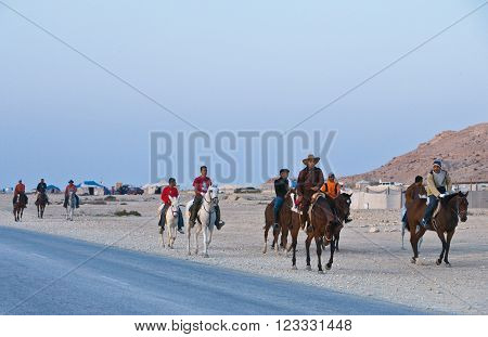 Sakhir,  Bahrain - January 12, 2007:  Local people on horses spending the week-end in the desert.