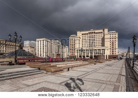 Moscow, Russia - March 20, 2016: View of the Manezhnaya Square and the State Duma against dark thunderclouds.