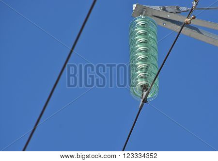 Insulators power lines. Photo of power lines against the blue sky.
