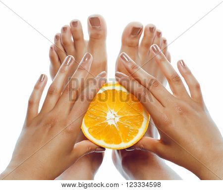 manicure pedicure on afro-american tann skin hands holding orange, healthcare concept isolated on white background