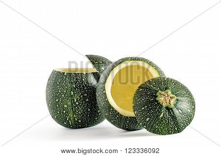 Couple of eight ball squash with cut top and scooped out pulp isolated on white.