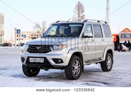 NOVYY URENGOY RUSSIA - JANUARY 30 2016: Motor car UAZ Patriot in the city street.